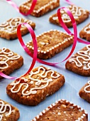 French 'pepper nut' biscuits decorated with icing sugar