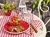 Cordon bleu stuffed with mozzarella with a tomato and melon salad
