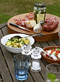 Various antipasti on a garden table
