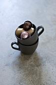 Espresso capsules in a coffee cup