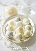 White chocolate pralines on a silver tray