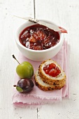 Plum jam in a bowl and on bread