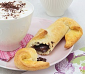 Pastry roll filled with chocolate