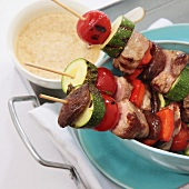 Lamb kebabs with cherry tomatoes, courgettes and peppers