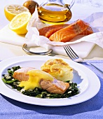 Salmon fillet with saffron sauce, spinach and potatoes au gratin