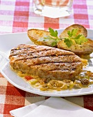 Pork steak with a mustard sauce and jacket potatoes