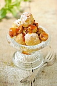 Mini profiteroles with gooseberry sauce