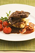 Fried lambs' liver with potatoes, tomatoes and bacon
