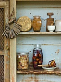 Preserved fruit on a wooden shelf