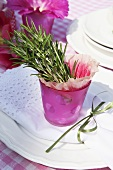Summery table decoration with rosemary and flowers
