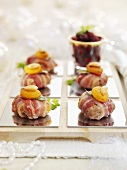 Christmas burgers wrapped in bacon with apricots and almonds