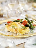 Salmon in puff pastry with green asparagus for Christmas dinner