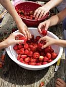 Children washing strawberries