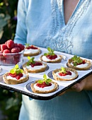 Tartlets with yogurt and rasperry jam in a muffin tin