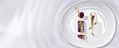 Cherry aspic with cream (molecular gastronomy)