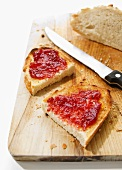 Toasted white bread with jam on a chopping board