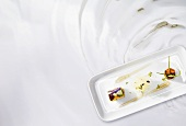 Vinegar rolls with a wild herb salad (molecular gastronomy)