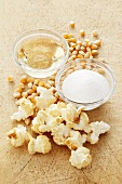 Popcorn and ingredients (corn seeds, salt, oil)