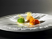 Vegetable ravioli, butter broth, almond oil (molecular gastronomy)