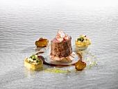 Veal fillet, lobster, parsley oil, peanut (molecular gastronomy)