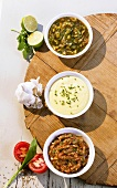 Lime sauce, potato-garlic sauce, tomato-chive sauce