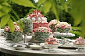 Festively decorated cakes and flower arrangments on a table