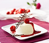 Panna cotta with raspberry sauce and a chocolate grid