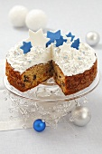 Fruit cake with meringue and sugar stars