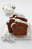 Christmas gingerbread loaf with raisins and icing sugar