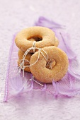 Ring-shaped cinnamon biscuits as Christmas tree decoration