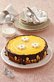 Cheesecake with chocolate and sugar stars for Christmas