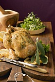Roast chicken with lemons and sage