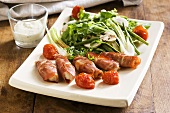 Chicken fillets wrapped in ham with a side salad