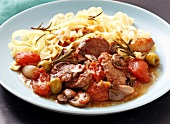 Pork ragout with tomatoes and tagliatelle