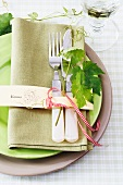 Place setting decorated with a vine leaf