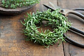 A rosemary wreath and a pair of scissors