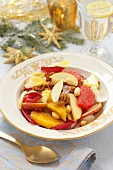 Citrus fruit salad with chicory, apple and nuts