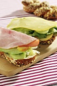 Wholemeal rolls with cucumber, apple, ham and cheese