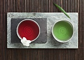 Two sorts of tea in bowls in a slab of stone