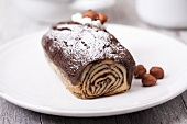 Chocolate-hazelnut Swiss roll dusted with icing sugar