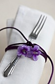 A napkin decorated with a scented violet