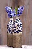 Hyacinths in painted bottles