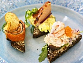 Canapes with salmon, scrambled egg and prawns