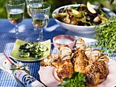 Grilled chicken legs and herb butter