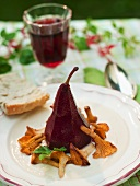 Red wine pear with chanterelle mushrooms
