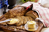 Bread being spread with butter