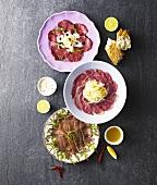 Beef carpaccio, duck carpaccio and tuna carpaccio