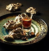 Chocolate cornflakes macaroons and a glass of liqueur
