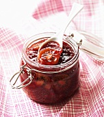 A jar of forest fruit and kiwi jam