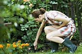 A young woman working in a garden